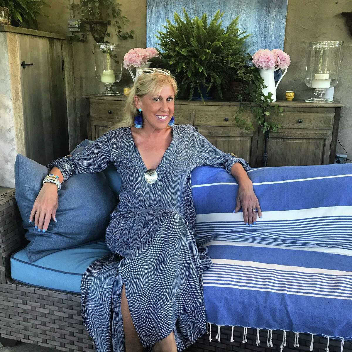Laurette Kittle poses in the Seychelles kaftan, one of many kaftan styles offered by her company Walker&Wade, which is based in Greenwich. This is the latest, and it already has a following. Kaftans, which have been around for thousands of years, are having a bit of a fashion moment.