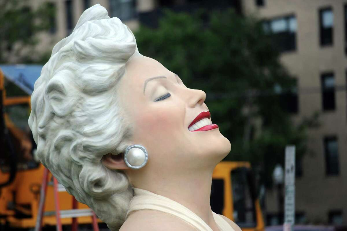 The head and torso of Marilyn Monroe waits to be placed on top of her billowing skirt in Latham Park in downtown Stamford, Conn. on Monday, June 4, 2018. The 26-foot, 30,000 pound statue named