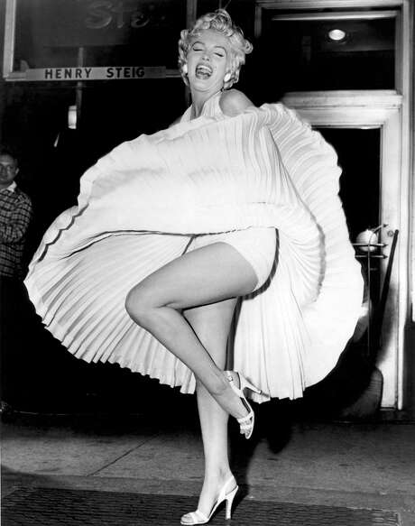 "The most famous dress in movie history is William Travilla's ""subway dress"" from ""The Seven Year Itch,"" a draped halter fit-and-flair dress cut on the bias with a pleated sunburst circle skirt. Published photographs of her in the dress catapulted her to pop culture queen. Reprinted with permission from ""Marilyn in Fashion,"" Running Press, 2012 Photo: Running Press / Melissa Geller/Running Press"