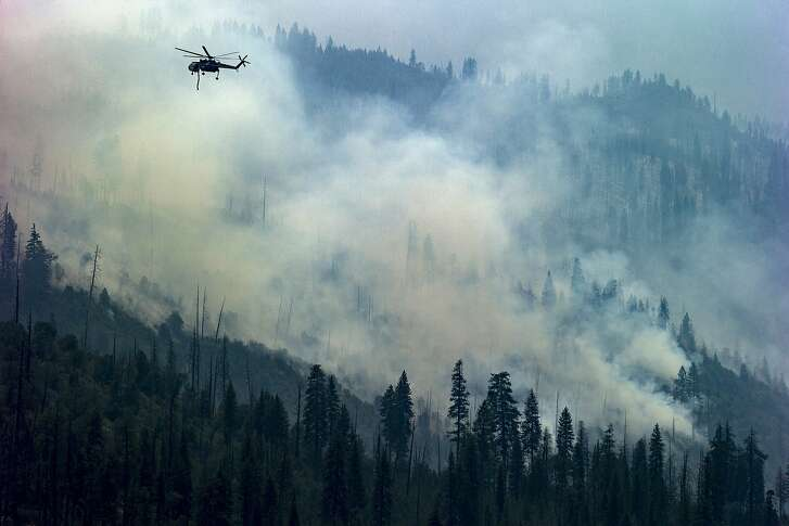 A helicopter battling the Ferguson Fire below Wawona Road at Yosemite National Park on Wednesday, Aug. 8, 2018, in Mariposa County, Calif.