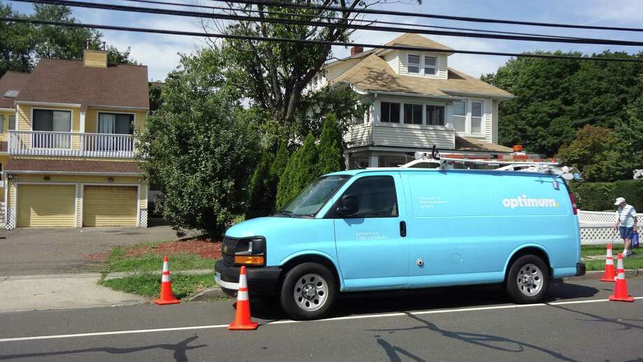 An Altice Optimum truck on a 2016 service call in Norwalk, Conn. The state dropped out of the top 10 nationally that year for household broadband adoption, according to estimates by the U.S. Census Bureau, with 84 percent of households subscribing to high-speed cable, DSL or wireless service. Photo: Alexander Soule / Hearst Connecticut Media / Stamford Advocate
