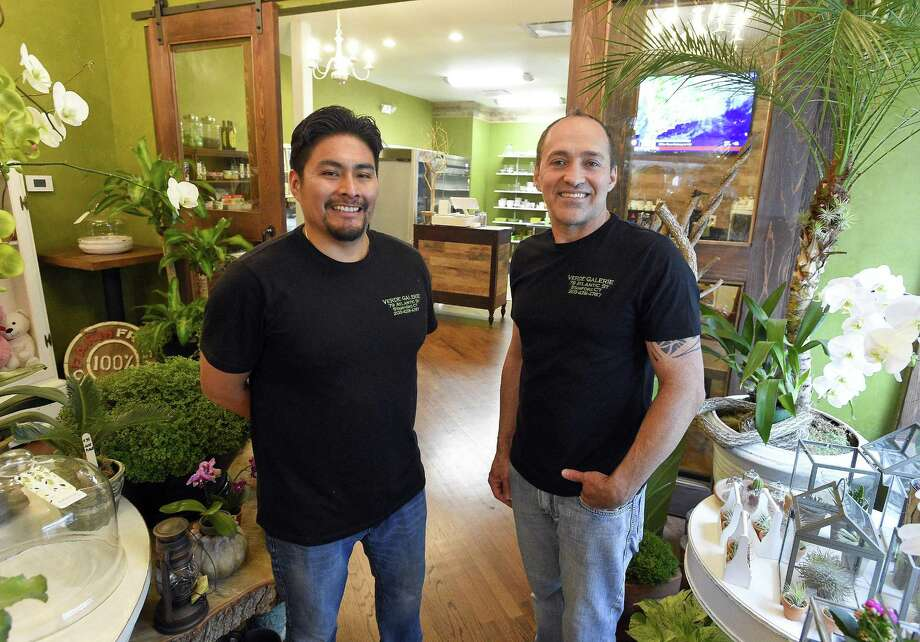 Co-owners Marcial Perez-Saunders, left, and Iris Oliveira stand in their new Verde Galerie florist-coffee shop at 79 Atlantic St., in downtown Stamford, Conn., on Aug. 1, 2018. Photo: Matthew Brown / Hearst Connecticut Media / Stamford Advocate