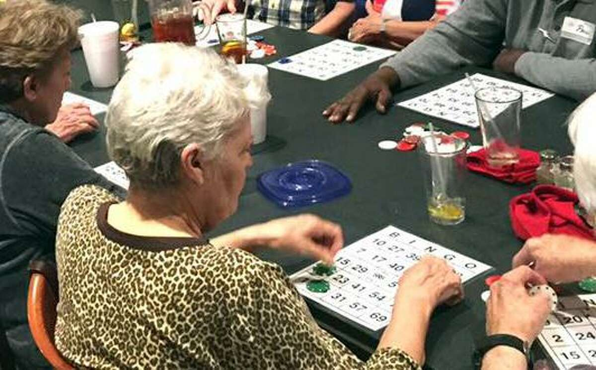 PHOTOS: More about dementia and Alzheimer's People play bingo during a monthly dinner hosted by the Kingwood Memory Cafe. Learn the facts about Alzheimer's ...