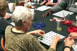 People play bingo during a monthly dinner hosted by the Kingwood Memory Cafe.