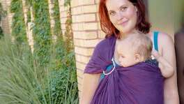 Krystal Fare is president of Babywearing International of San Antonio, the Alamo City chapter of the nonprofit group that advocates the practice of carrying a baby in a wrap or other carrier. Fare, pictured with her youngest daughter Tabitha at The Pearl, said a lot of her group's parents are millennials