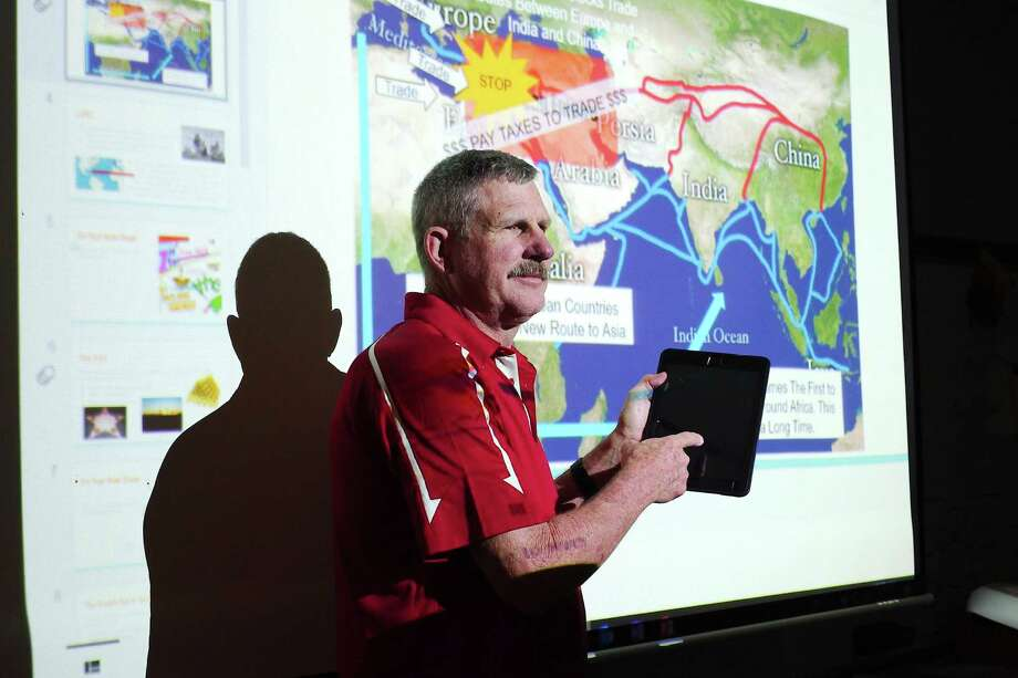 Ipads and digital projectors are used daily in the classroom of Deer Park Junior High social studies teacher and coach Harold Flynn. He said he appreciates how technology has helped in teaching children with different styles of learning. Photo: Kirk Sides / Houston Chronicle / © 2018 Kirk Sides / Houston Chronicle