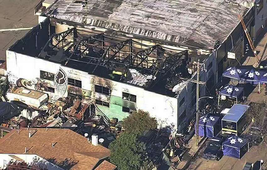 FILE - This Dec. 3, 2016, file image from video provided by KGO-TV shows the Ghost Ship Warehouse after a fire swept through the building in Oakland, Calif. Two men who pleaded no contest to 36 charges of involuntary manslaughter will face the family members of those who died in a fire at an illegally converted Northern California warehouse. A two-day sentencing hearing for Derick Almena and Max Harris is scheduled to begin Thursday, Aug. 9, 2018, in Oakland. (KGO-TV via AP, File)
