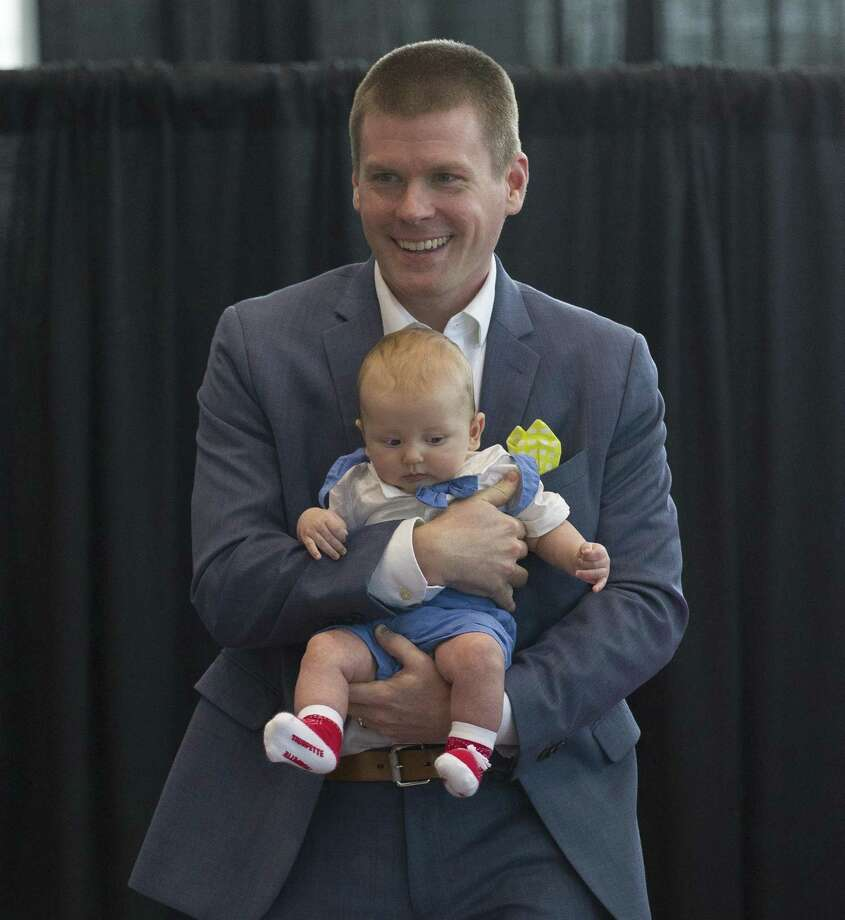 McKesson Corporation's Brent Wunderlich, who walked the runway with his newborn son, during the annual Real Men of Montgomery County fashion show at Wiesner Buick GMC on Thursday, Aug. 9, 2018, in Conroe. Photo: Jason Fochtman, Staff Photographer / Houston Chronicle / © 2018 Houston Chronicle