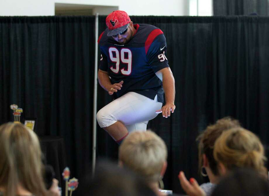 Ryan Morton dresses up like Houston Texans' JJ Watt during the annual Real Men of Montgomery County fashion show at Wiesner Buick GMC on Thursday, Aug. 9, 2018, in Conroe. The event raised money for the Conroe/Lake Conroe Area Chamber of Commerce. Photo: Jason Fochtman, Staff Photographer / Staff Photographer / © 2018 Houston Chronicle