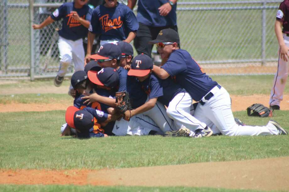 The Prospect Hills Mustang all-stars celebrate their South Zone title over Deer Park's boys at the Ruth Minchen Athletic Complex. In California, Prospect Hills went 0-2 at the World Series, losing to a team from North Carolina and another squad from California. Photo: Robert Avery