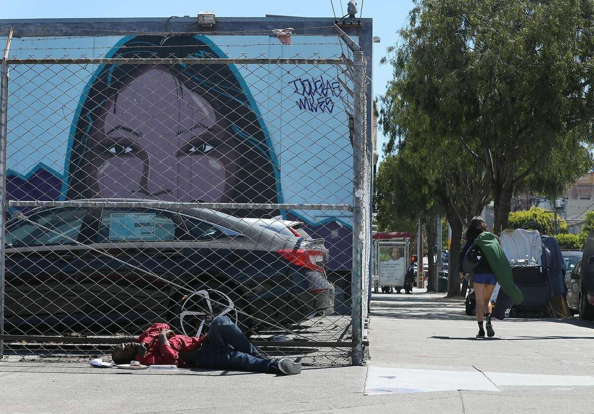 Man sleeping on Shotwell at 16 streets seen on Monday, Aug. 6, 2018 in San Francisco, Calif. Two years after they were shot to death in the box they lived in at a homeless camp on Division Street, there have been no arrests and the homeless camp no longer exists.