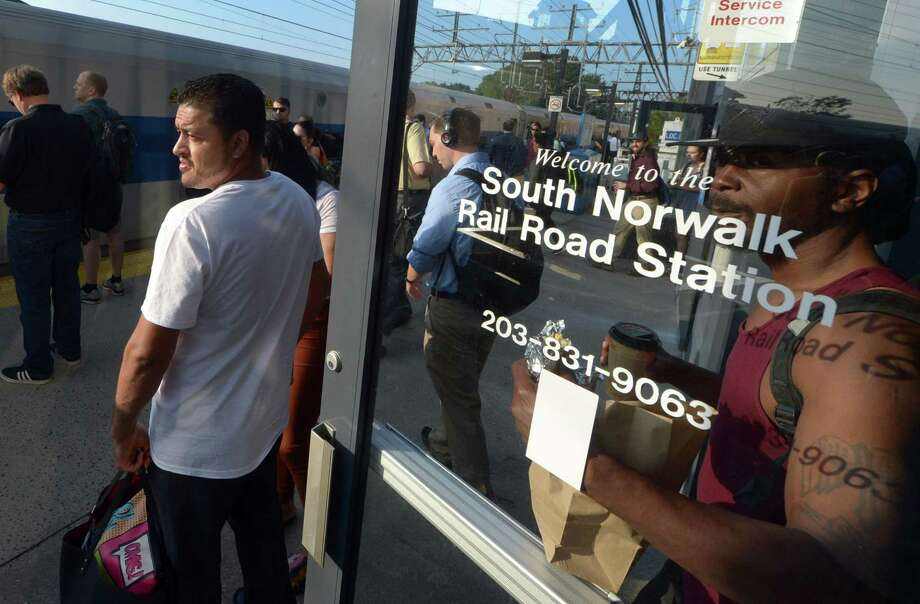 Commuters wait to board a train to New York from the South Norwalk Railroad Station Wednesday, August 8, 2018, in Norwalk, Conn. The majority of people who work in Norwalk do not live here, and the majority of people who live in Norwalk do not work here. This trend has increased significantly over recent years. Photo: Erik Trautmann / Hearst Connecticut Media / Norwalk Hour
