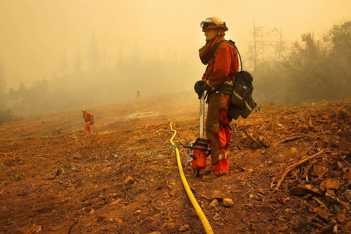 Jeremy Roberson an inmate firefighter with the Cal Fire McCain Valley crew keeps watch on hot spots as firefighters continue to battle the Detwiler Fire on the outskirts of Mariposa, Ca., on Wednesday July 19, 2017.