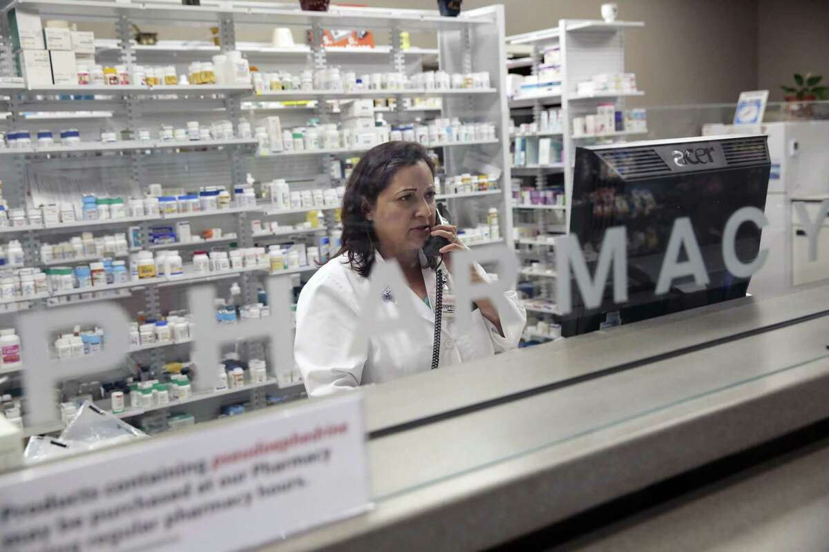 A pharmacist at work in Rohnert Park, Calif., in 2015. The price of certain drugs varies widely depending on what city they are sold in, but prices are higher generally because insurers and those who manage prescriptions for them are hoarding rebates.