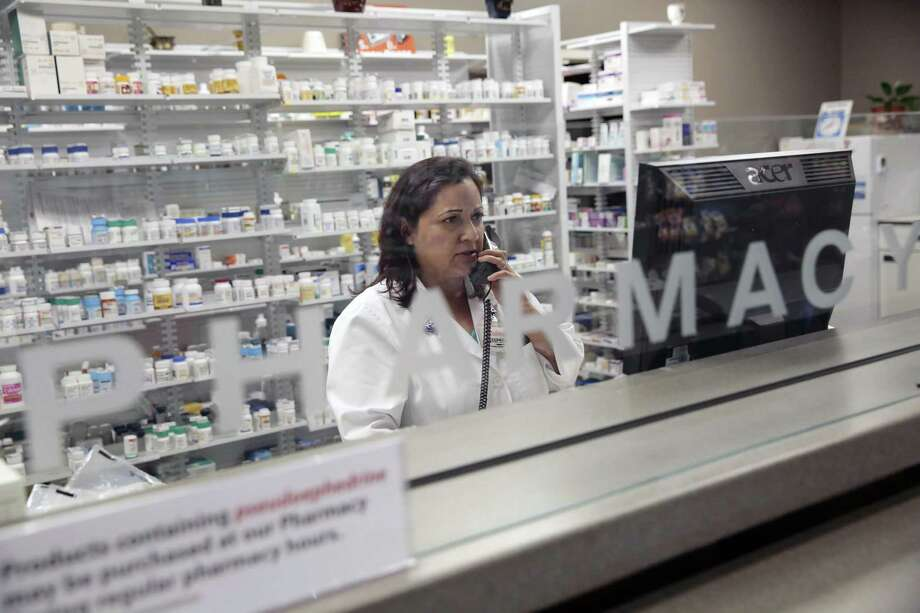 A pharmacist at work in Rohnert Park, Calif., in 2015. The price of certain drugs varies widely depending on what city they are sold in, but prices are higher generally because insurers and those who manage prescriptions for them are hoarding rebates. Photo: RAHIM RAHIMIAN /NYT / NYTNS