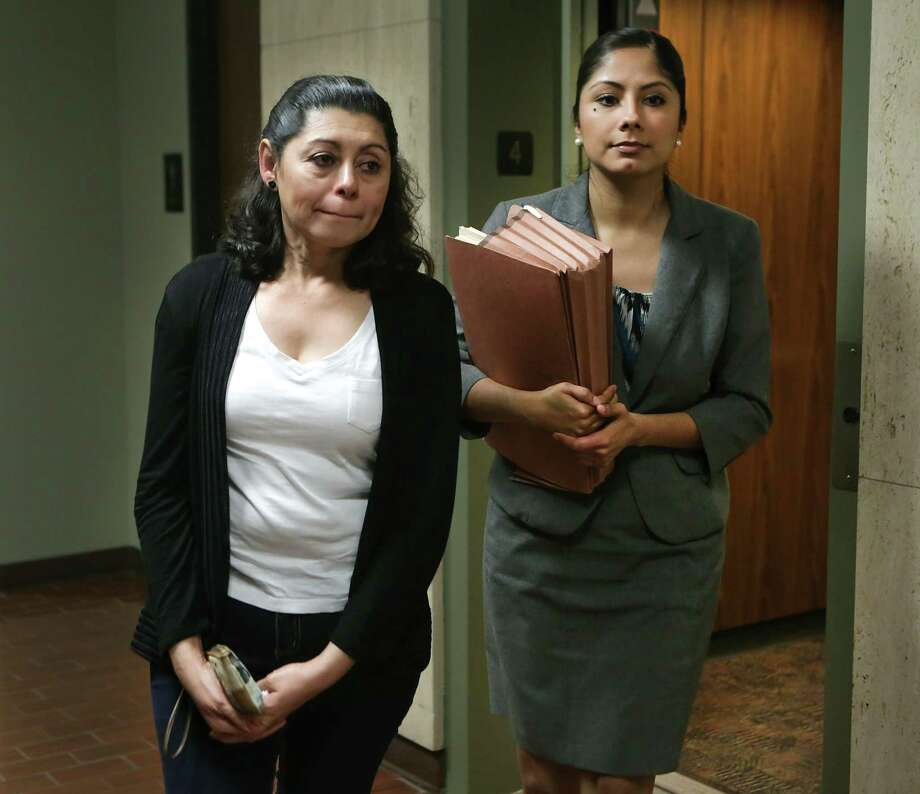 A distraught Lesly Cabrera, left, walks with Claudia Hernandez, her lawyer, following the judges decision in immigration court. Cabrera, a Honduran mother who is seeking asylum here due to gang violence aimed at her 17 year-old son while they were in San Pedro Sula, was denied application to asylum on May 18, 2015. Rejection will be more common with Attorney General Jeff Sessions' decision to remove fear of domestic or gang violence as reasons to grant asylum. Photo: Bob Owen /San Antonio Express-News / San Antonio Express-News