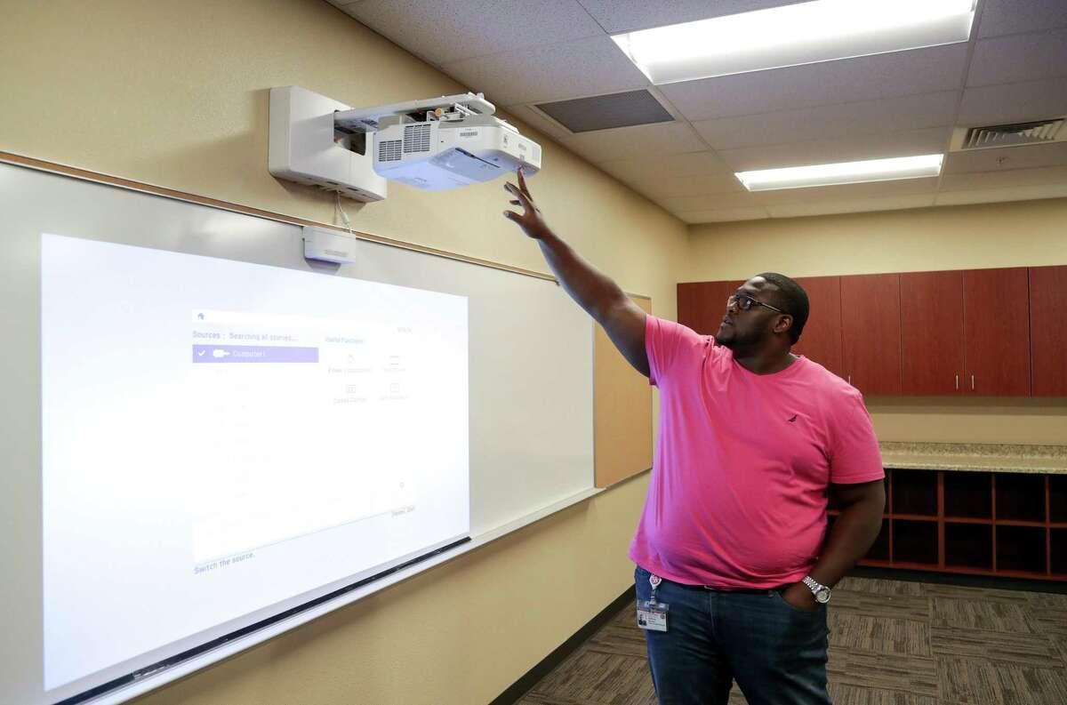 Joshua Brown, principal at International Leadership of Texas, tests an interactive white board at the campus, Friday, Aug. 3, 2018, in Houston.