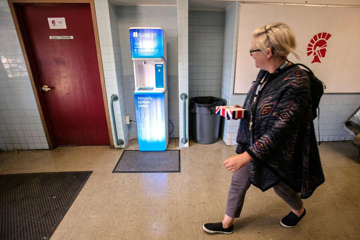 A Skyline High school staff member walks passed the new hydration station, which will be replacing the some of the regular water fountains, due to the continuing lead contamination issues through the school district, Thursday 09 August 2018 in Oakland, CA.