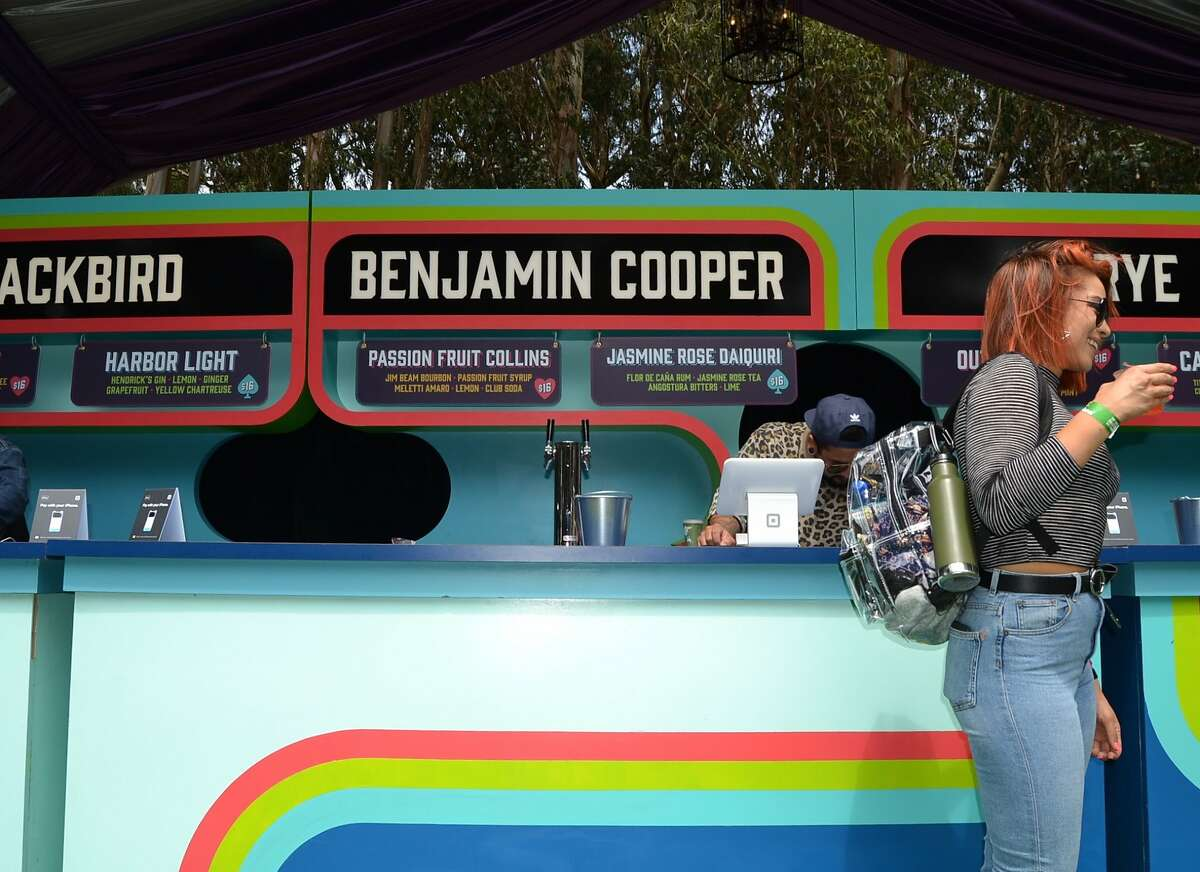 Bartenders at Cocktail Magic pour drinks for Outside Lands Music Festival attendees on August 10, 2018.