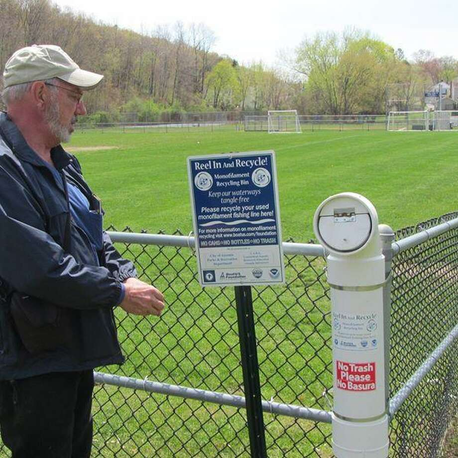 Dave Connelly, Ansonia's IT director, shows the sign designating people to recycle used fishing line. Photo: Contributed / Ansonia City Hall