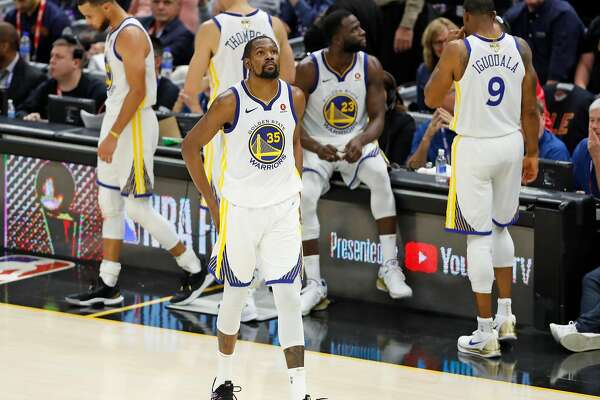Golden State Warriors' Kevin Durant looks focused as he leaves a time out with Stephen Curry, Klay Thompson, Draymond Green and Andre Iguodala during 4th quarter of Warriors' 110-102 win over Cleveland Cavaliers in Game 3 of the NBA Finals at Quicken Loans Arena in Cleveland, OH on Wednesday, June 6, 2018.