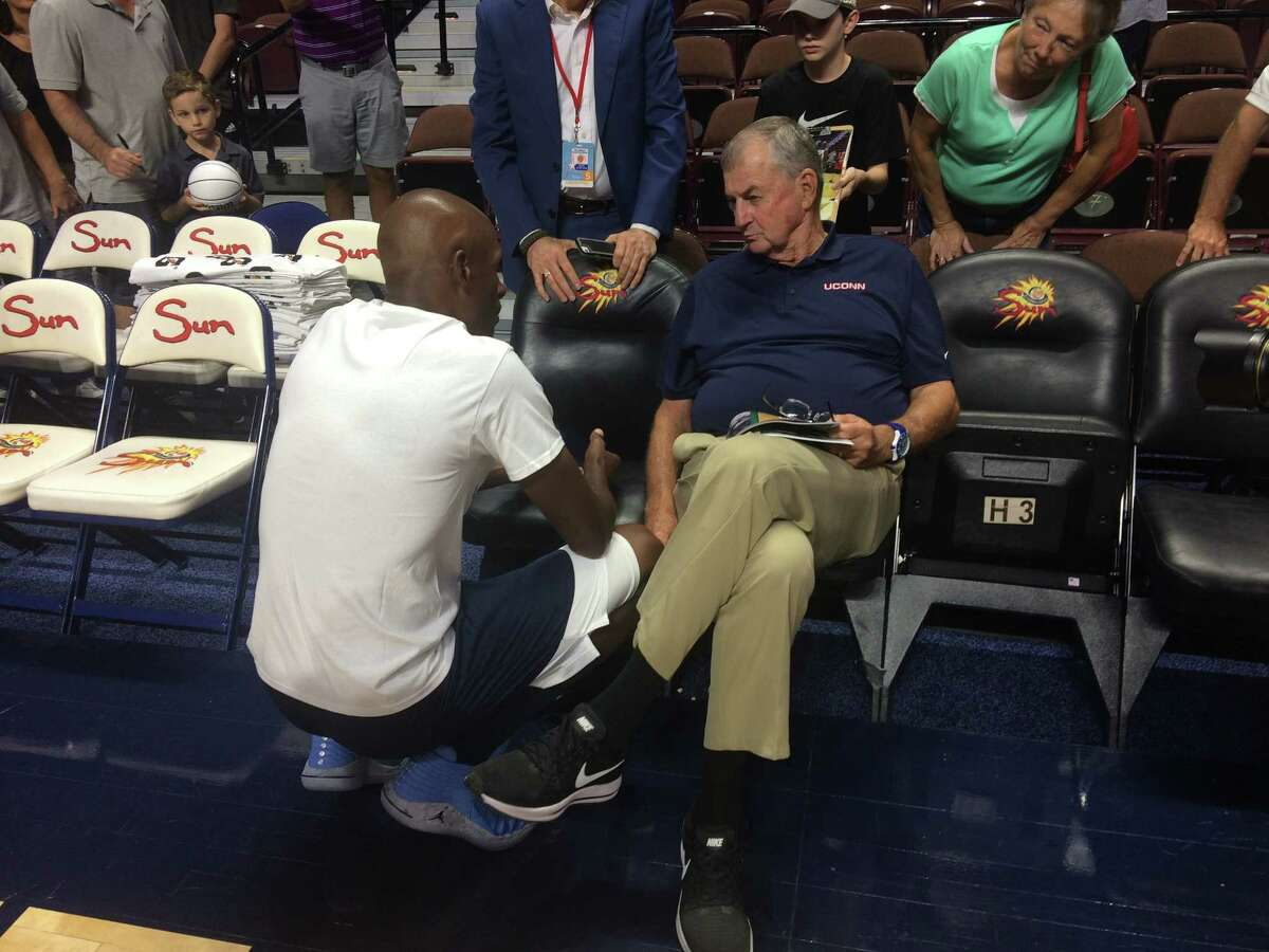 Former UConn star and Basketball Hall of Famer Ray Allen speaks with his former Huskies coach Jim Calhoun at the Jim Calhoun Celebrity Classic Charity All-Star Game at Mohegan Sun Area in Uncasville, Conn. on Friday, August 10, 2018.