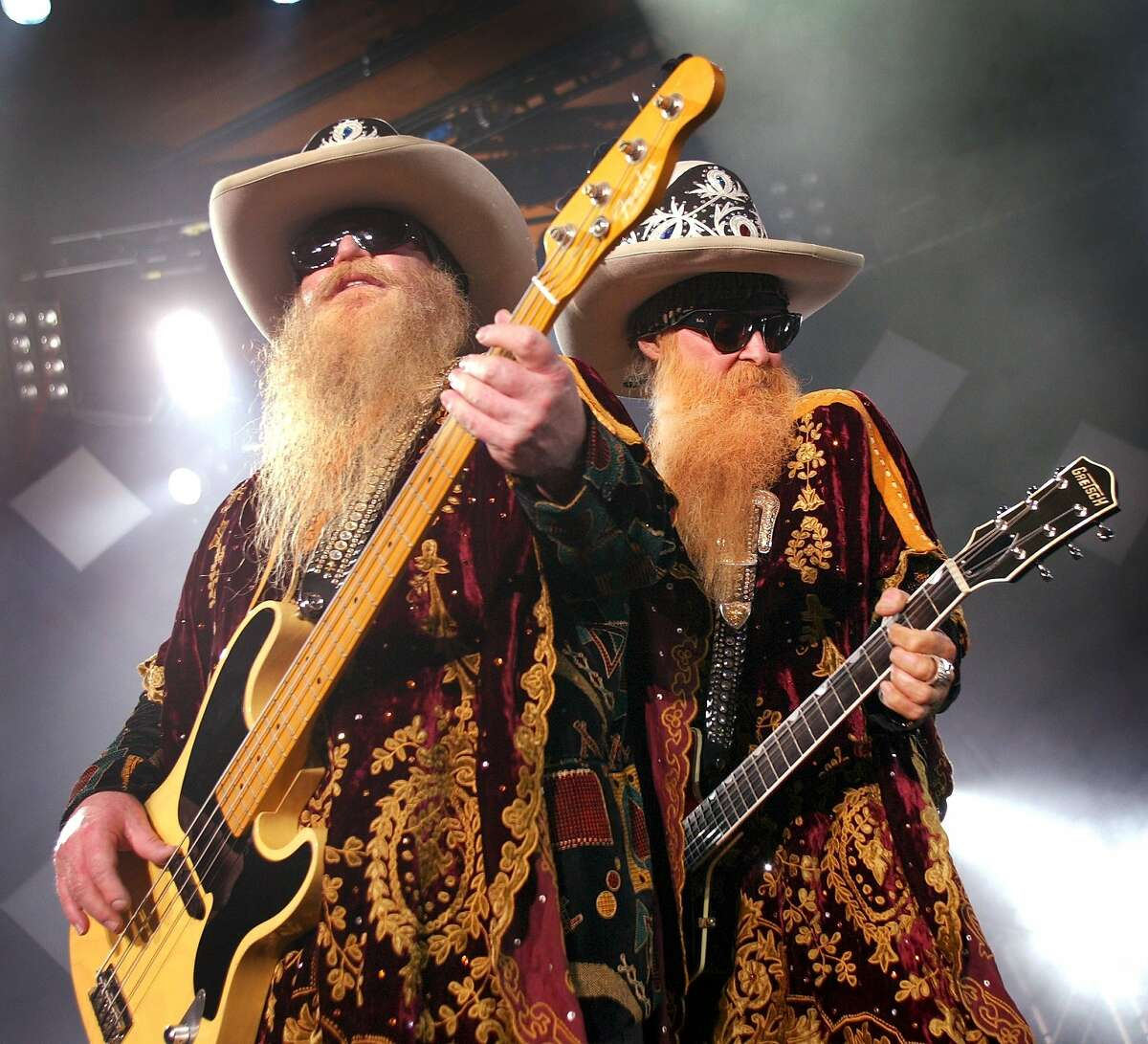 Lead singer and guitarist Billy F. Gibbons, right, and bass player Dusty Hill of the Texas rock group ZZ Top perform on the last night of the 37th Montreux Jazz Festival in Montreux, Switzerland, late Sunday, July 20, 2003. (AP Photo/Keystone/Fabrice Coffrini)