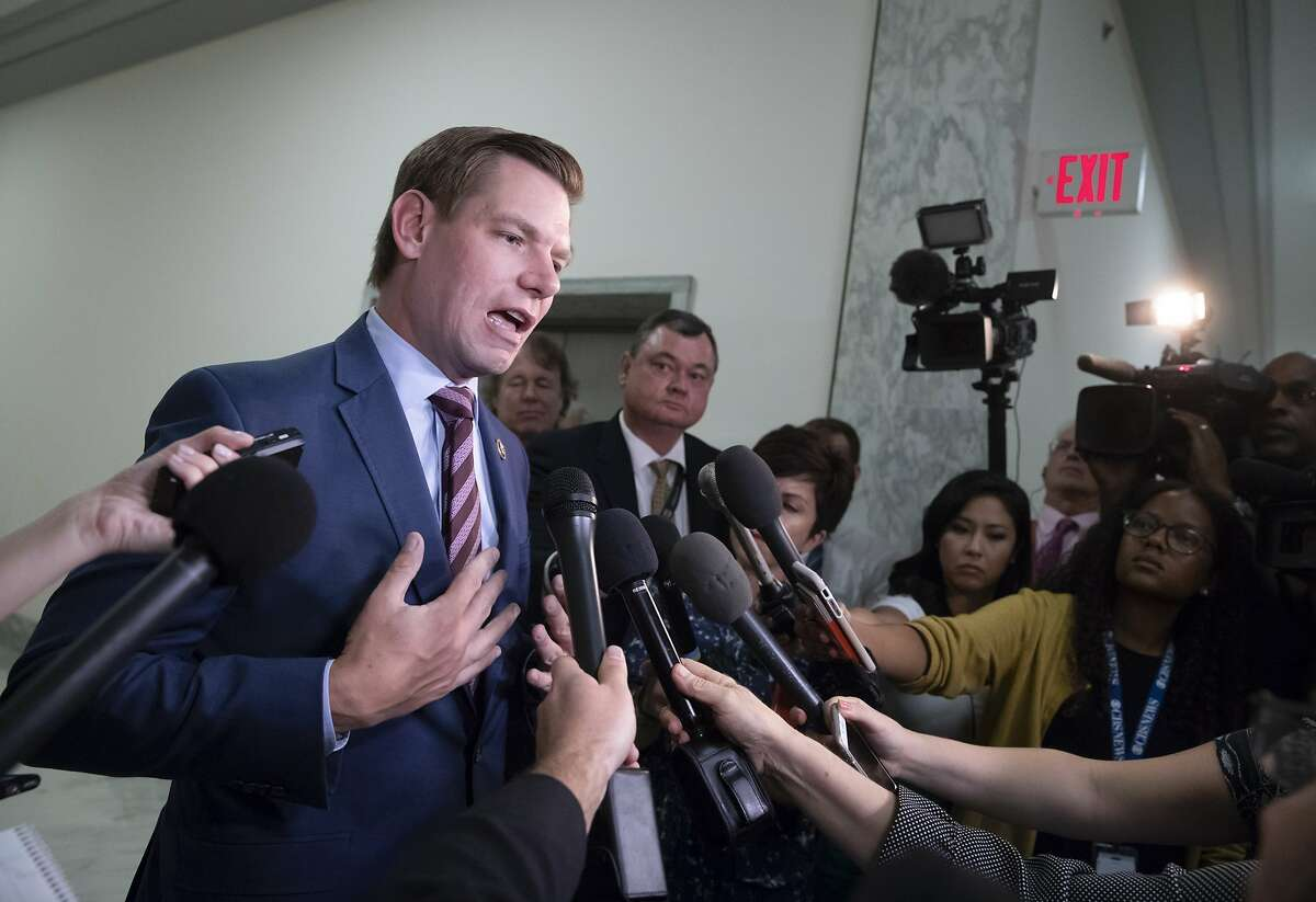 Rep. Eric Swalwell, D-Calif., pauses to speak with reporters as former FBI lawyer Lisa Page is questioned behind closed doors by members of the House Judiciary Committee and House Oversight Committee on whether political bias affected the investigations of Hillary Clinton's emails and the Trump campaign's alleged ties to Russia, on Capitol Hill in Washington, Monday, July 16, 2018. (AP Photo/J. Scott Applewhite)