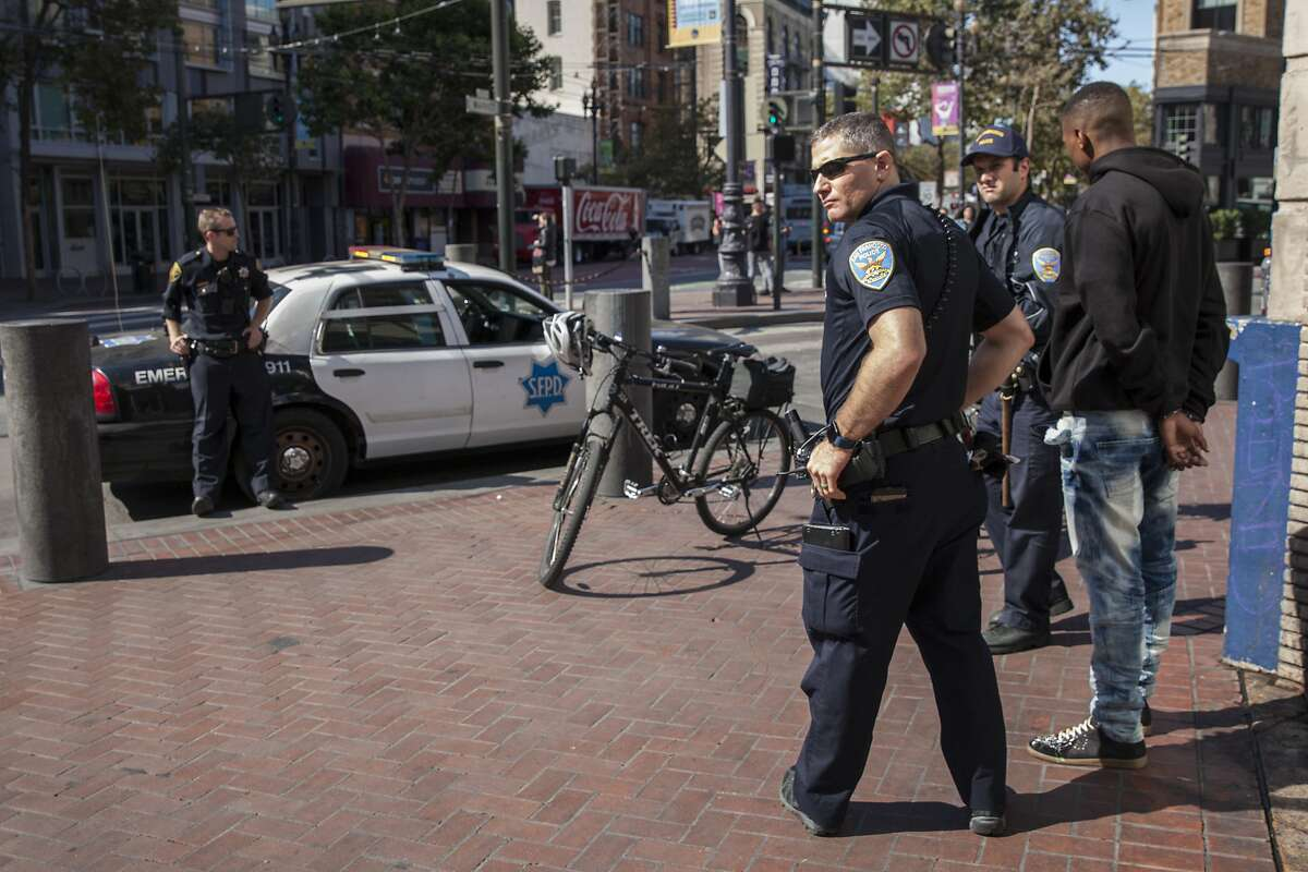 San Francisco beat cops on bicycles detain an unidentified individual along Market Street during their patrols of the Mid-Market Street area. A large increases in spending from the recently enacted $11 billion budget will go to foot and bicycle patrols, Friday 10 August 2018 in San Francisco, CA.