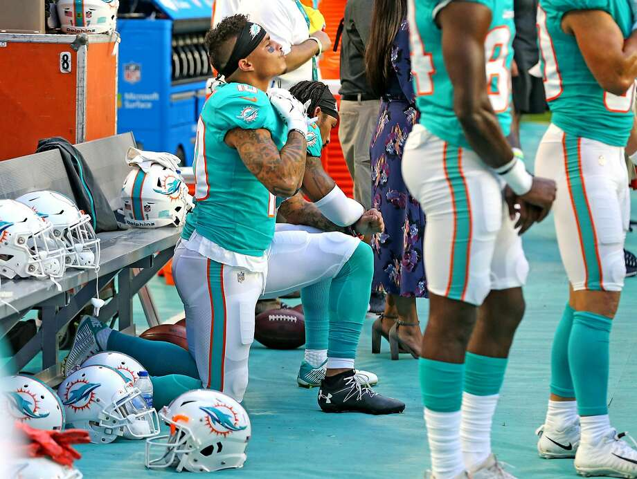 Miami Dolphins receivers Kenny Stills and Albert Wilson kneel during the national anthem as they prepare to play the Tampa Bay Buccaneers at Hard Rock Stadium in Miami Gardens, Fla., on Thursday, Aug. 9, 2018. (Charles Trainor Jr./Miami Herald/TNS) Photo: Charles Trainor Jr., TNS
