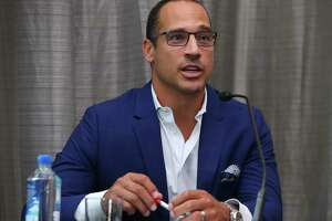 "WEEI's Christian Fauria speaks during the ""Changing the Game of Racial Ignorance Toward Asians in Media: Learning from the WEEI Incident"" panel at the Asian American Journlaists Association on Friday, Aug. 10, 2018, in Houston. Boston Globe Columnist's Shirley Leung, NBC 10, Boston's Jonathan Choe and ESPN's Michele Steele were on the panel."