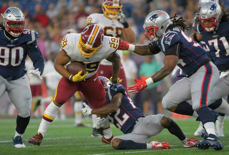 ec19af8c6a8 Redskins running back Derrius Guice (29) carries the ball against the  Patriots in Thursday s
