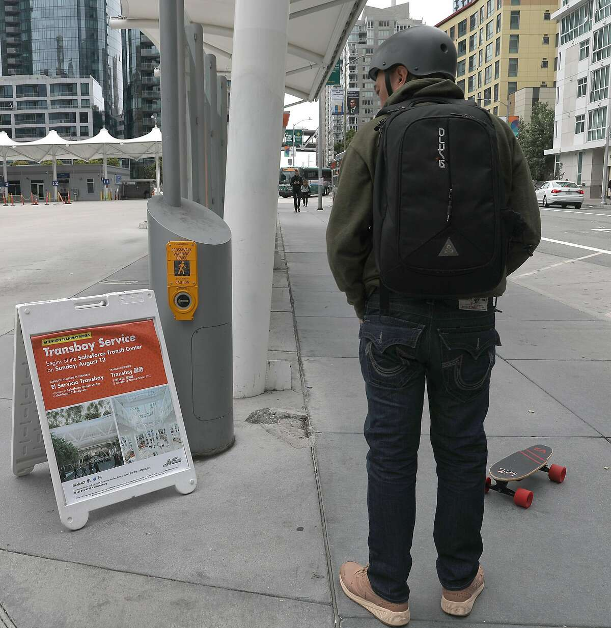 John Diamonon commuting from Union City reads about the moving schedule of The Temporary Transbay Terminal which is going to become a park and affordable housing after the new terminal opens after today on Wednesday, Aug. 8, 2018 in San Francisco, Calif.