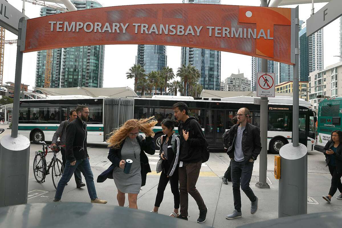 Passengers pass by The Temporary Transbay Terminal which is going to become a park and affordable housing after the new terminal opens on Wednesday, Aug. 8, 2018 in San Francisco, Calif.
