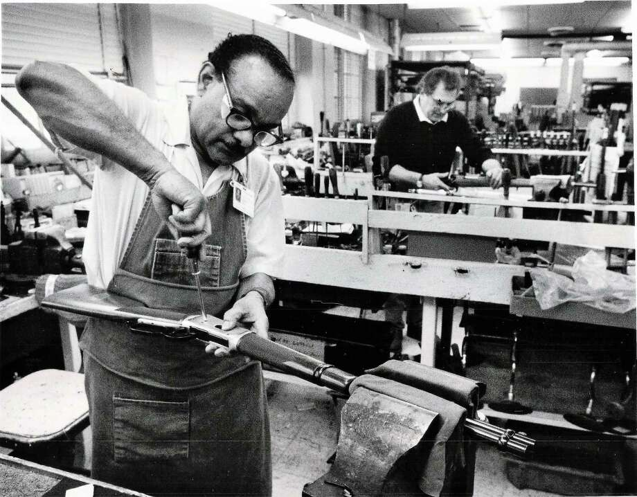 Men repair model 94 guns in the product services department at U.S. Repeating Arms Co. The photo is dated November 1990. Photo: Hearst Connecticut Media File Photo