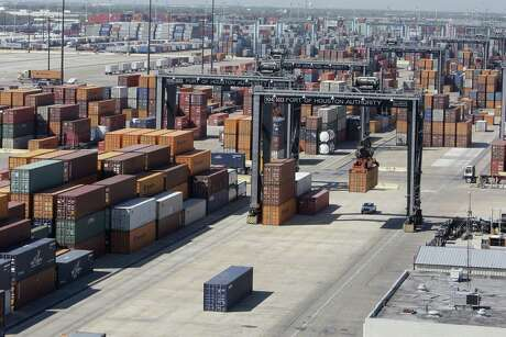 Shipping containers being unloaded from ships at The Port Authority of Houston Barbours Cut Container Terminal. Houston's economy relies on a steady flow of trade with other countries to keep it growing, according to an annual economic report.