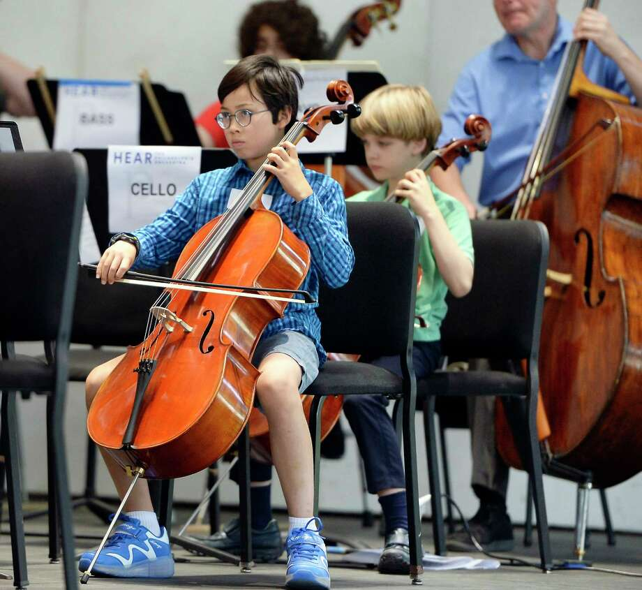 "Cellist Yugo Sato,11, left, of Clifton Park performs under the baton of Yannick Nézet-Séguin, music director of The Philadelphia Orchestra, during a ""PlayIN"" at SPAC Friday August 10, 2018 in Saratoga Springs, NY.  (John Carl D'Annibale/Times Union) Photo: John Carl D'Annibale / 20044498A"