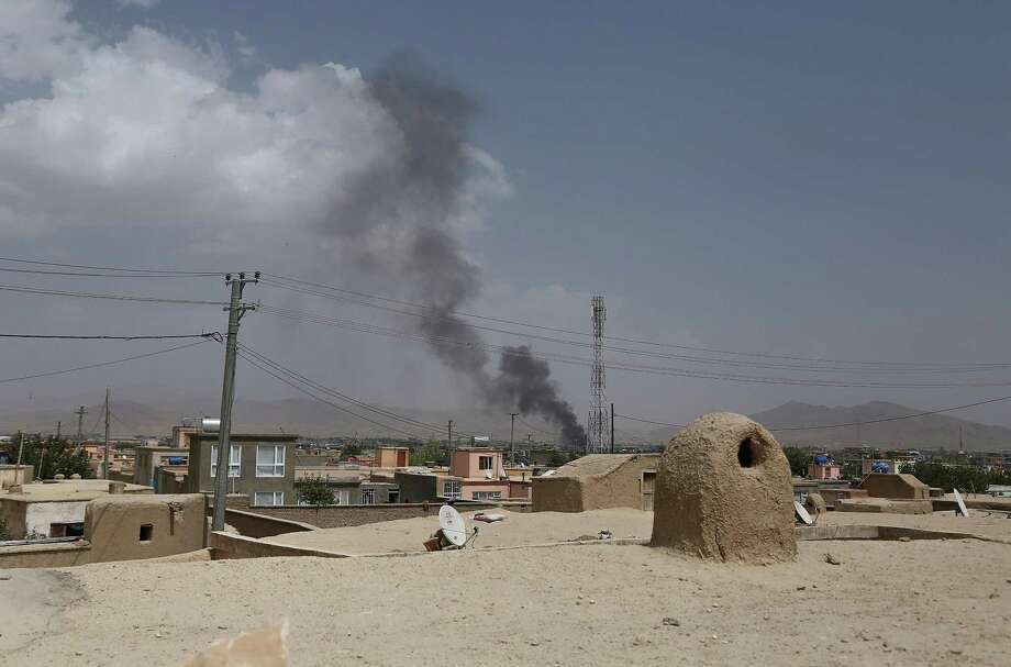Smoke rising into the air after Taliban militants launched an attack on the Afghan provincial capital of Ghazni on August 10, 2018. - US forces launched airstrikes on August 10 to counter a major Taliban assault on an Afghan provincial capital, where terrified residents cowered in their homes amid explosions and gunfire as security forces fought to beat the insurgents back. (Photo by ZAKERIA HASHIMI / AFP)ZAKERIA HASHIMI/AFP/Getty Images Photo: ZAKERIA HASHIMI / AFP or licensors