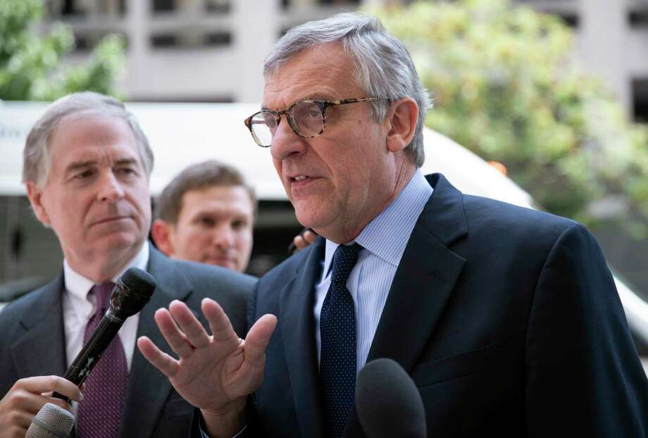 Paul Kamenar, attorney for Andrew Miller, joined by Peter Flaherty, chairman of the National Legal and Policy Center, left, talks to reporters after a federal judge found Miller in contempt for refusing to testify before the grand jury hearing evidence in special counsel Robert Mueller's investigation of Russian interference in the 2016 presidential election, at the District Court in Washington, Friday, Aug. 10, 2018. (AP Photo/J. Scott Applewhite) Photo: J. Scott Applewhite / Copyright 2018 The Associated Press. All rights reserved