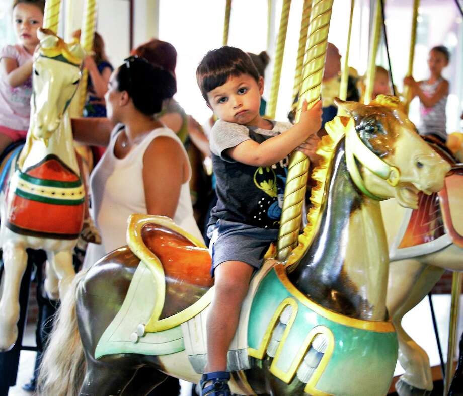 Three-year-old Paul MacArthur of Saratoga Springs doesn't seem to have made up his mind about the Congress Park Carousel Friday August 10, 2018 in Saratoga Springs, NY.  (John Carl D'Annibale/Times Union) Photo: John Carl D'Annibale