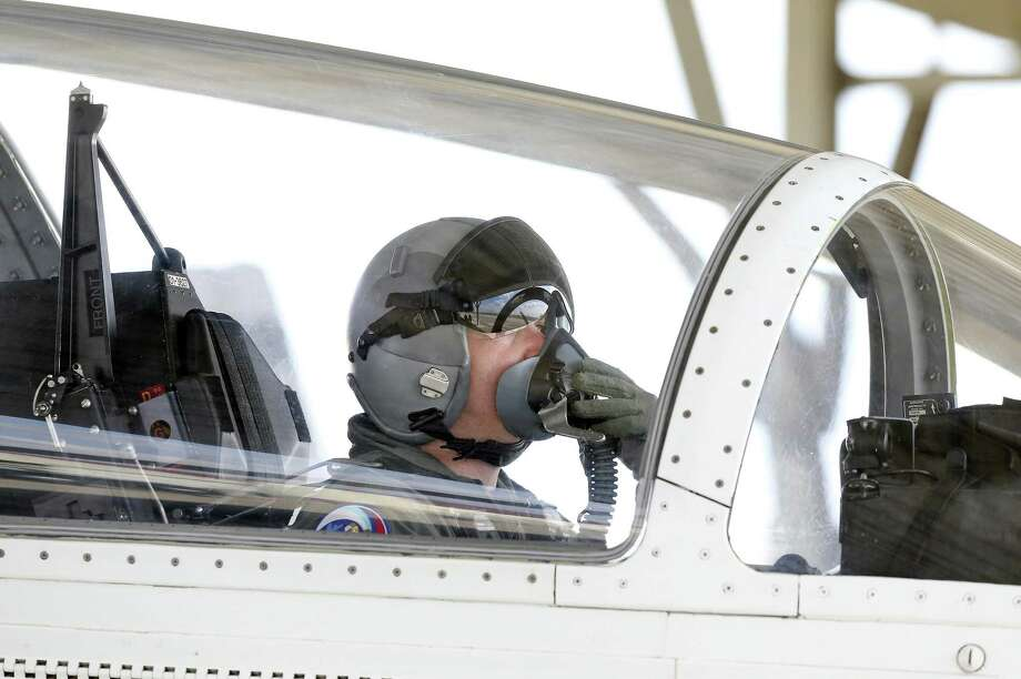 A pilot adjusts his oxygen mask as his crew prepares to fly T-6A aircraft at Joint Base San Antonio-Randolph on March 2, 2018. Photo: Tom Reel, Staff / San Antonio Express-News / 2017 SAN ANTONIO EXPRESS-NEWS