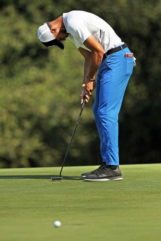 Stephen Curry hangs his head after a missed putt on hole No. 4. He had a 9 on hole No. 3. Photo: Scott Strazzante / The Chronicle