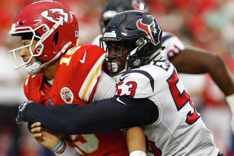 Houston Texans linebacker Duke Ejiofor (53) hits Kansas City Chiefs quarterback Patrick Mahomes (15) during the first quarter of an NFL football game at Arrowhead Stadium on Thursday, Aug. 9, 2018, in Kansas City.