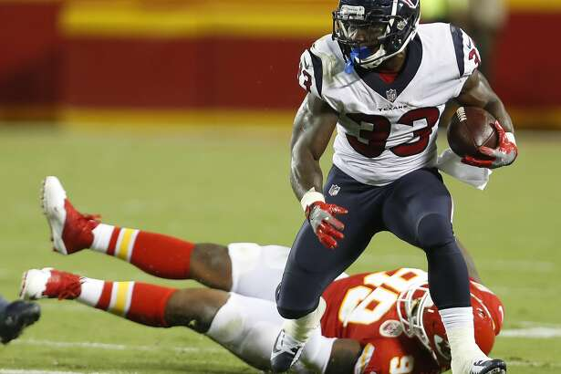 Houston Texans running back Troymaine Pope (33) breaks away from Kansas City Chiefs defensive tackle T.Y. McGill (99) during the third quarter of an NFL football game at Arrowhead Stadium on Thursday, Aug. 9, 2018, in Kansas City.
