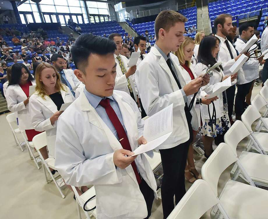 Images from Quinnipiac University's Frank H. Netter MD School of Medicine White Coat Ceremony for the members of the class of 2022 Thursday, August 9, 2018 at the People's United Center in Hamden. Photo: Catherine Avalone, Hearst Connecticut Media / New Haven Register