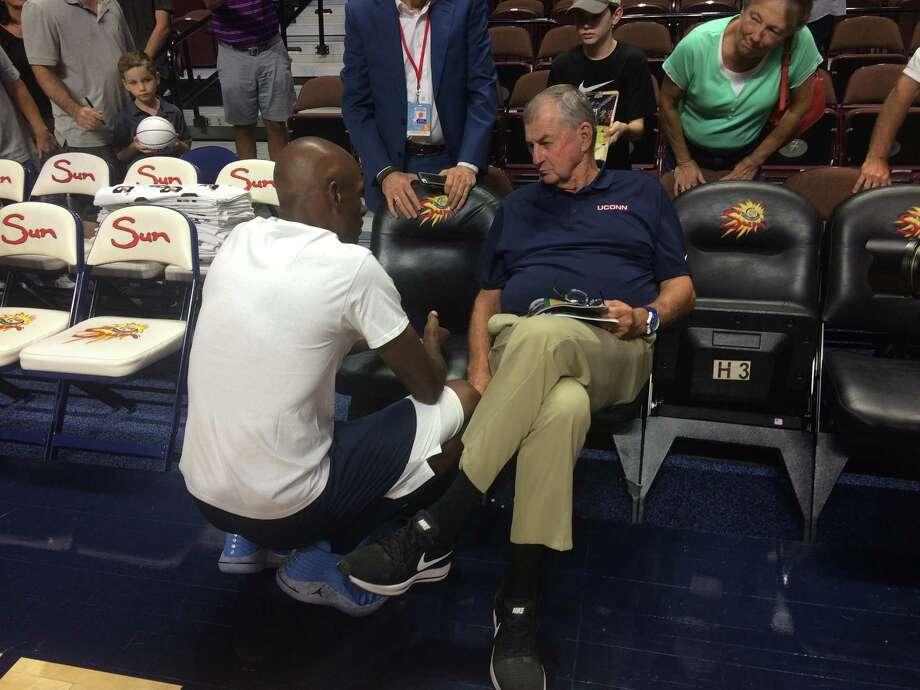 Former UConn star Ray Allen speaks with his former Huskies coach, Jim Calhoun, at the Jim Calhoun Celebrity Classic Charity All-Star Game on Friday. Photo: Doug Bonjour / Hearst Connecticut Media / Stamford Advocate Contributed