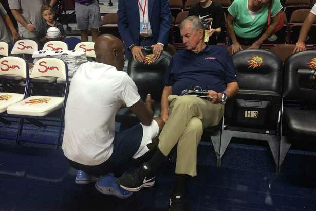 Former UConn star Ray Allen speaks with his former Huskies coach, Jim Calhoun, at the Jim Calhoun Celebrity Classic Charity All-Star Game on Friday.