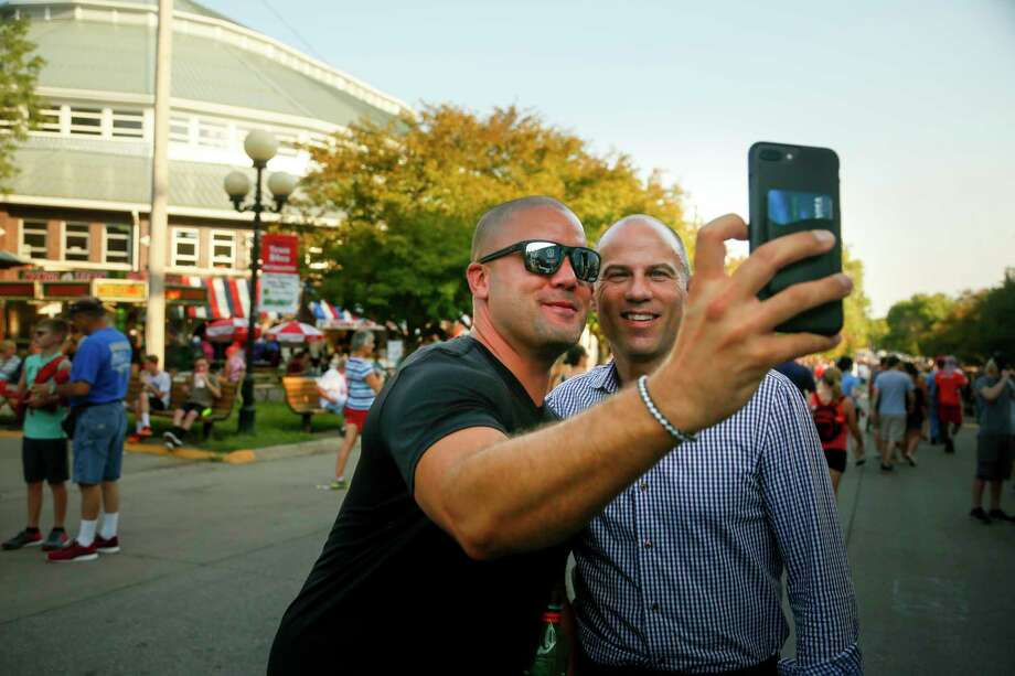 "Michael Avenatti, the lawyer representing adult film actress Stormy Daniels, poses for a selfie with a fairgoer at the Iowa State Fair in Des Moines, Iowa, Thursday, Aug. 9, 2018. Avenatti's crusade for the porn actress taking on President Donald Trump has already catapulted him to cable news stardom and endeared him to many frustrated liberals. Now the self-styled ""dragon slayer"" is taking his message to Iowa Democrats. (Zach Boyden-Holme/The Des Moines Register via AP) Photo: Zach Boyden-Holme / The Des Moines Register"