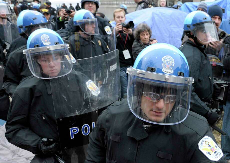 FILE - In this Feb. 4, 2012 file photo, U.S. Park Police are seen working in riot gear in Washington.  Government and police officials in the nation's capital say they are confident the city can manage to host this weekend's planned white nationalist rally without violence. A small rally will take place Sunday in front of the White House and the participants may be dwarfed by larger counter-protests with police keeping the two sides apart. (AP Photo/Cliff Owen) Photo: Cliff Owen / FR170079 AP