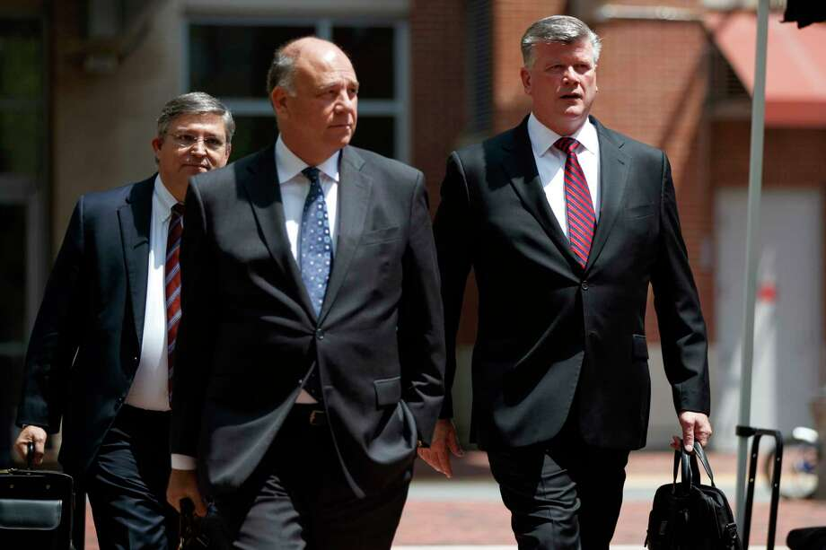 The defense team for Paul Manafort, including Kevin Downing, right, Thomas Zehnle, center, and Richard Westling walk to federal court during the trial of the former Trump campaign chairman, Friday, Aug. 10, 2018, in Alexandria, Va. (AP Photo/Evan Vucci) Photo: Evan Vucci / Copyright 2018 The Associated Press. All rights reserved.